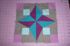 An original block design using half rectangle triangles, half sqaure triangles and squares