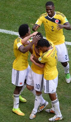 Colombia Holds Off Ivory Coast 2-1 In Furious Finish At World Cup - Colombia's midfielder James Rodriguez (C) celebrates with teammates after scoring a goal during the Group C football match between Colombia and Ivory Coast at the Mane Garrincha National Stadium in Brasilia during the 2014 FIFA World Cup on June 19, 2014.