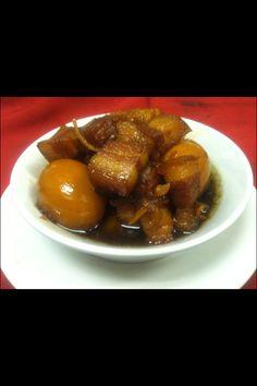 Thom Khem, Laotian camelized pork belly and egg.