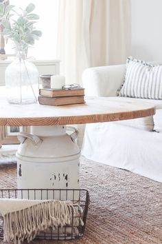 How to turn an old milk can into a gorgeous coffee table! See how this blogger created a unique piece of furniture perfect for her farmhouse at LoveGrowsWild.com:
