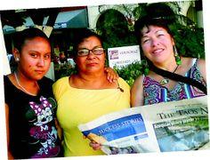 Valeria, Maria Ester and Lisa enjoy The Taos News in the main plaza of Veracruz, Mexico.