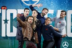 Jason Momoa Photos - (L-R) US actor Ezra Miller, US actor Jason Momoa, Israeli actress Gal Gadot, US actor Ben Affleck, US actor Ray Fisher and British actor Henry Cavill pose for a selfie photograph at a photocall for the film 'Justice League' in central London on November 4, 2017. / AFP PHOTO / Tolga AKMEN - 'Justice League' Photocall