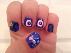 Dory-inspired nail art from the movie Finding Nemo.