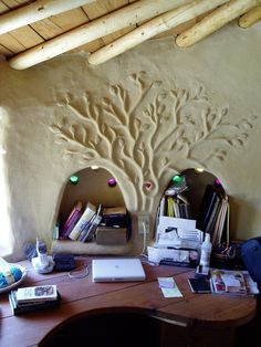 WOW!!! cob wall design with sculpted tree, arch shelves and  coloured glass windows
