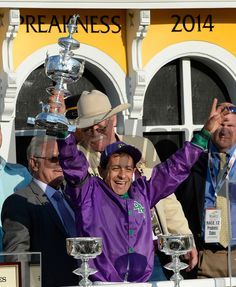 Jockey Victor Espinoza holds the winner's trophy aloft after California Chrome won the second leg of Thoroughbred racing's Triple Crown with his win in the 139th running of The Preakness Stakes Saturday evening May 17, 2014 at Pimlico Race Course in Baltimore, Maryland. (Skip Dickstein Photo) Pimlico Race Course, Derby, Preakness Stakes, Triple Crown Winners, Baltimore Maryland, Thoroughbred, Horse Racing, Chrome, California