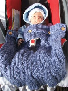 This is such a beautiful, blue blanket with buttons for the car seat. Without the hole, a blanket for wherever. Wow!