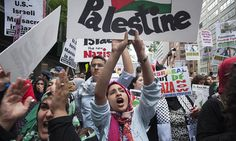 """Protesters shout, """"Free Palestine"""", during a march demanding an end to the escalating Israeli-Palestinian hostilities in that region, in midtown Manhattan, New York July 9, 2014.   — Photo by Reuters"""
