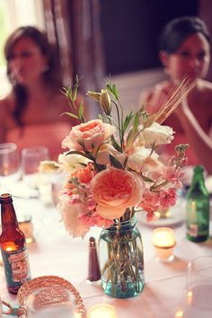 Southern (Savannah) vintage wedding. Peachy flowers in a mason jar. Photography by estherlouise.com/