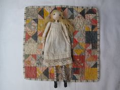 A doll that has its own patchwork quilt or its own toy. (Sarah Strachan) Feels like double comfort : )