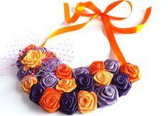 He encontrado este interesante anuncio de Etsy en https://www.etsy.com/es/listing/185969595/fabric-flower-necklace-bridesmaid