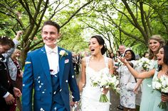 Frensham Heights Bride & Groom.  Flowers created by Eden Blooms Florist from Cream Freesia, Dusty Miller, Rosemary, Sweet Pea, Eucalyptus Parvifolia, Green Bell, Avalanche Rose & White Peony.  Image by www.fionasweddingphotography.co.uk