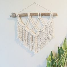 This hand-crafted modern macramé wall hanging is made from 100% cotton Canadian-made rope, and driftwood gathered from the shores of Lake