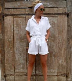 Penny Linen Playsuit - Collared, Button Down, White Linen Jumpsuit Romper Features Cap Sleeves with folded hem Shell Buttons Shorts with Folded Hem Buttons down Self-Tie Linen Belt with Belt Loops Soft elasticised waist Shipping Delivered in the U.S. 1-2 weeks from purchase. Fabric: 100% Linen Style: Hannah Dress Linen Colours Available: White - s i z e g u i d e - Medium size photographed Small Length Front: 83cm Length Back: 93cm Bust: 60cm Arm Length: 41cm Medium Length Front: 85cm Length…