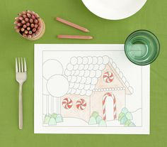 Gingerbread House PlacematA mealtime masterpiece with no assembly required (phew). Print this gingerbread house (download it here) and let your little artists decorate during dinner.