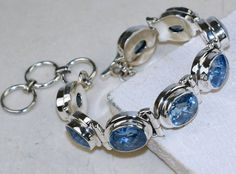 Blue Topaz bracelet designed and created by Sizzling Silver. Please visit  www.sizzlingsilver.com. Product code: BR-8542