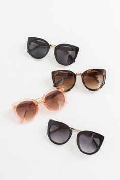 "Our new Trisha Cat Eye Sunglasses are perfect for year round wear! These chic sunnies come in four must have colors and adds a feminine-edgy touch to any ensemble! Sunglasses measure 2.25"" x 5.5"". All"