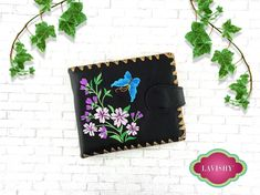From Elma collection designed by vegan brand LAVISHY, this medium bifold wallet features colorful butterfly and cherry blossom flower embroidery motif and framed with decorative stitches around the edge. Made with Eco-friendly vegan materials are Eco-friendly and cruelty free. It's great for everyday use as well as a delightful gift for your family and friends. Gift Packaging: They come with FREE LAVISHY gift box to make gift giving easier and more fun! Wholesale available at www.lavishy.com Embroidery Motifs, Flower Embroidery, Cherry Blossom Flowers, Gift Packaging, Wallets For Women, Boutique Clothing, Cruelty Free, Stitches, Eco Friendly