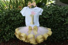 Baby Girl 1st Birthday Outfit - Light Pink and Gold Ribbon Trim Tutu with Onesie or T-Shirt with Gold Age Number and Pink Crown plus Hairbow...