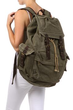 Product Description * Canvas travel rucksack backpack. * Double shoulder straps with short handle.. * Zipper top closure. * Interior zip, wall and cell phone pockets * Exterior pocket. * Dimensions: 1