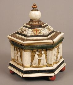 Hexagonal box,early 15th century.  North Italian. Wood,bone polychromy,gilding.Ivory.