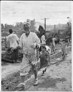 South Koreans of all ages make their way along a dirt road, before the US landing at Inchon. 1950