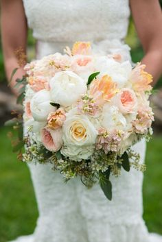 Gorgeous white and peach bouquet with peonies and ranunculus