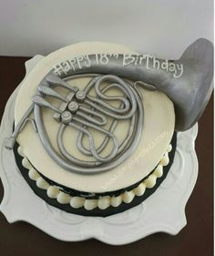 French horn cake Www.facebook.com/simplycakes.brittneyshiley