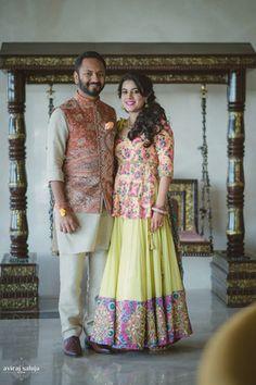Mehendi Outfits - Coordinated Mehendi Colorful Outfits | WedMeGood | Bride in a Lemon Lehenga with Pink and Blue Kurta and Groom in a Beige Kurta with Multi Colored Nehru Jacket  #wedmegood #Indianbride #indiangroom #lehenga #indianwedding #mehendi #outfits