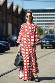 Twinset maxi with Givenchy buckle sandals, round sunnies, and half bun.