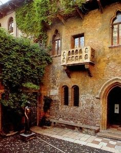 Romeo and Juliet Balcony in Verona, Italy. The statue in the courtyard has one shiny breast from being rubbed by people who want to be lucky in love.