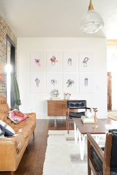 Genius and inexpensive way to fill up a giant wall with art!