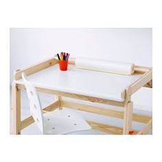 IKEA - FLISAT, Children's desk, , The desk can be adjusted to three different heights, so it can be used for homework or arts and crafts for many years.The desktop can be tilted to help your child vary their work posture.The groove prevents pens and other smaller items from falling down when the desktop is tilted.Your child can keep drawing paper on hand at all times, as the desk has a holder dimensioned for MÅLA drawing paper roll.If you need extra storage, you can add TROFAST storage b...