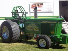 Rollin Stone JD pulling tractor