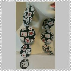 """Poker Playing Cards Extra Long Earrings This lucky playing cards ace diamond clubs spade heart Joker Kings dangle big earrings have 4 tiers and are 10"""" long. The largest tier is  approximately 1 7/8"""" in diameter.  These earrings are brand new and are made of fabric. The print on your new earrings will be the same. The print placement may be different. Custom Made Jewelry Earrings"""