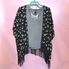 Floral Kimono  Floral kimono from Hollister. One size, very flowy and airy great for the spring/ summer!! The fringe at the bottom gives it a more festival feel! worn twice very good conditionno trades  Hollister Tops