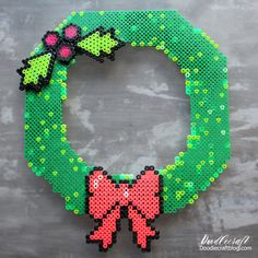 8 Bit Geekery Perler Bead Wreath DIY I love perler, melty or hama beads. They are so much fun to use and melt. They just scream 8 bit with their pixel like image. I thought I would take advantage of that and make a Geek inspired wreath.