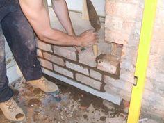 Blocking up a Door way below is another doorway in the basement hence the concrete lintel