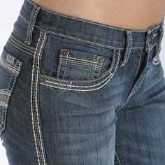 (SIDE) The medium stonewash ABBY is free-spirited and has a determination that can't be stopped. The smoke, cream, and khaki stitching take on the design of a feather along the front pocket seams, while soaring across the back pockets. The heavy hand sanding, permanganate, and resin whiskers give strength to the triple needle stitch design.  CB42154071 IND