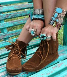Wide bracelets, shoes, and big rings