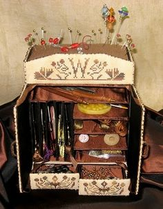 a beautiful sewing box. It's an online class, but could make one with chipboard.