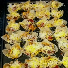 Bite size tacos in mini muffin pans! Won ton wrappers, shredded chicken, taco seasoning, salsa and shredded cheese. Bake at 425F until won tons are golden brown.