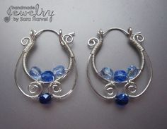 silver hoop earrings with blue glass beads