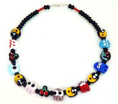 joy of packman's world on your neck :)  made of handmade glass beads..  www.burcutansug.com