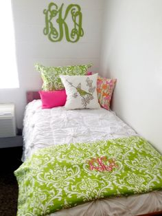 Monogram above bed. i love the monogrammed patterned throw