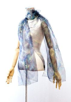 New type of scarf. This happens to be the worlds lightest scarf, made from Amaike Super-Organza fabric. To put it bluntly, when you walk into a room wearing this, it flows making the entrance that more spectacular. I have to get one of these!