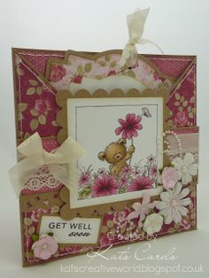 Pink criss cross card with a pull out tag and featuring a LOTV image coloured with Copics