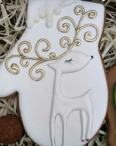 Snowy white mitten, deer with gorgeous eyelashes and golden antlers, Russian cookie artist