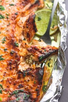 PREP TIME 5 mins COOK TIME 25 mins TOTAL TIME 30 mins Baked honey cilantro lime salmon in foil is cooked to tender, flaky perfection in just 30 minutes with a flavorful garlic and honey lime glaze. Baked Salmon Recipes, Fish Recipes, Seafood Recipes, Dinner Recipes, Cooking Recipes, Healthy Recipes, Salmon Dishes, Fish Dishes, Seafood Dishes
