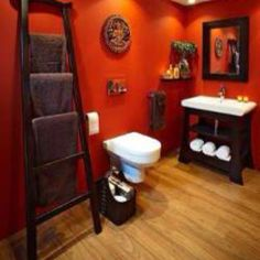 I love the ladder being used as a towel rack. I also love the burnt orange!