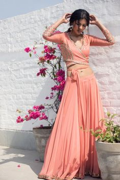Coral peach georgette wrap-around crop top with gota embroidery and skirt with a flared organza dupatta. Lengha Blouse Designs, Choli Designs, Fancy Blouse Designs, Lehenga Blouse, Blouse Patterns, Lehenga Choli, Anarkali, Dress Indian Style, Indian Fashion Dresses